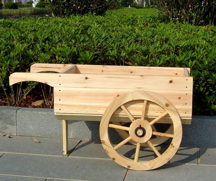 Wooden wheelbarrow planter decorative display cart for Decorative lawn ornaments